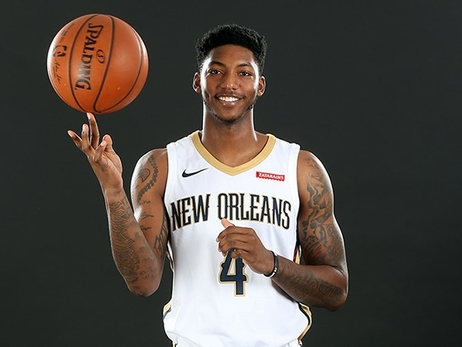 Elfrid Payton spins a ball during a photo shoot