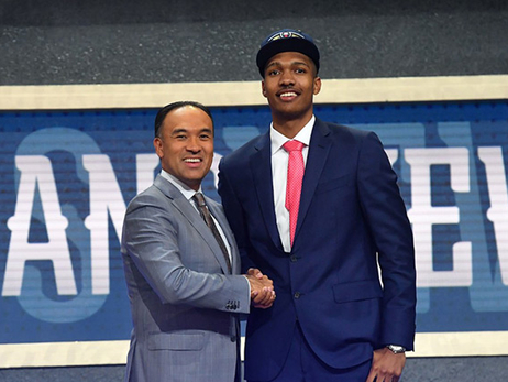 New Orleans second-round pick Tony Carr greets Mark Tatum
