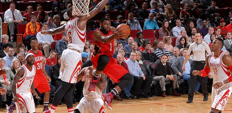 Tyreke Evans dips under the rim for a reverse layup at Houston