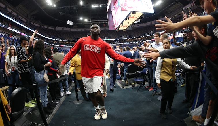 Zion Williamson gives high-fives to fans Oct. 11 after a preseason win over Utah