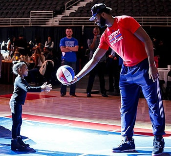 Andre Drumnond and a young fan