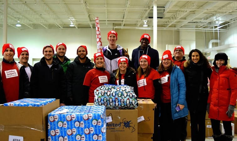 Jakob Poeltl and Pascal Siakam at the Holiday Helpers