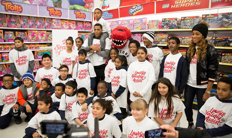 Kyle Lowry at a holiday shopping spree with elementary students