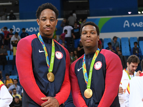 DeMar DeRozan & Kyle Lowry pose with their gold medals
