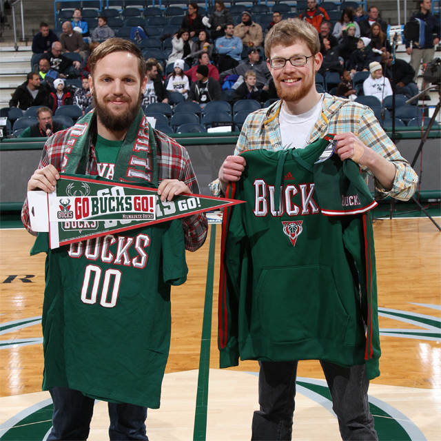 The first #GoBucksGo winner Brandon (right) poses with his new gear with his friend Andrew.