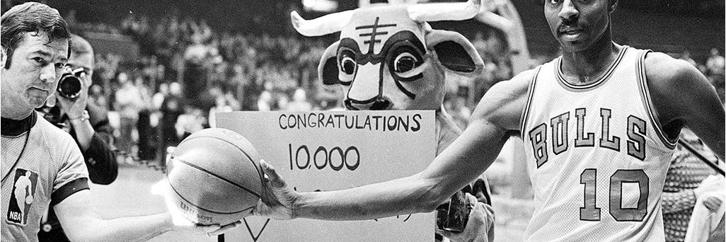 Benny from the past holds a sign up for a Bulls Player