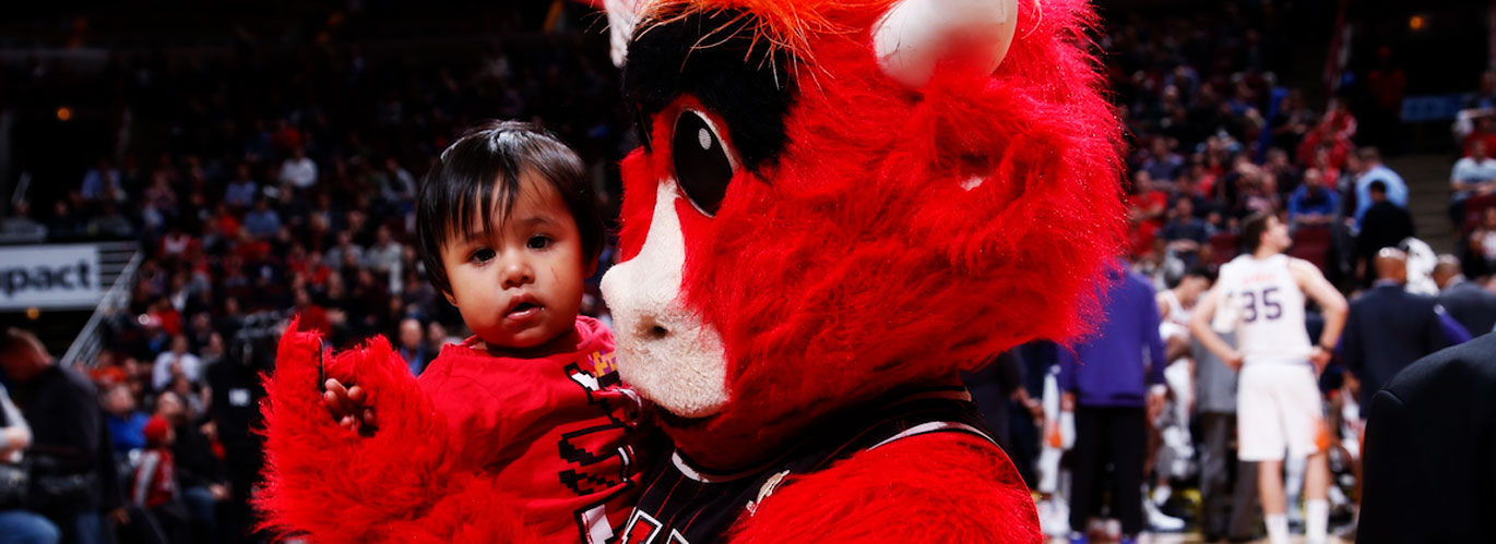 Benny the Bull and a child.