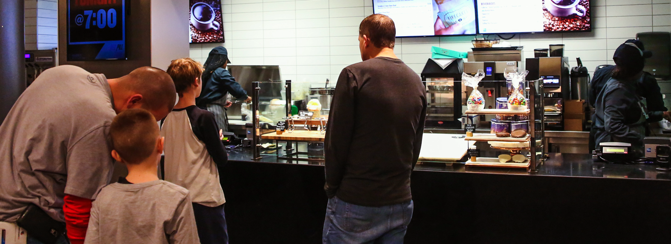 Fans standing in line to order food at a United Center game.