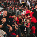 Fans enjoying Benny the Bulls's performance during a game.