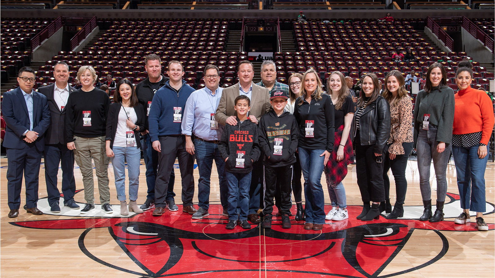 Fans taking a photo on the Bulls center court