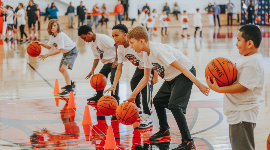 Children dribble during a basketball camp