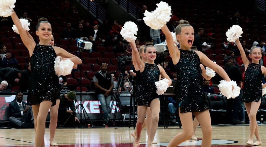 A dance team performing before a Bulls game