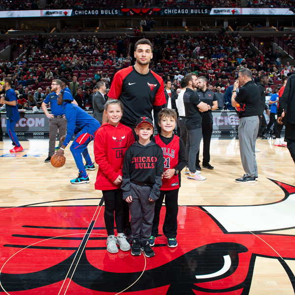 Zach and child fans on center court
