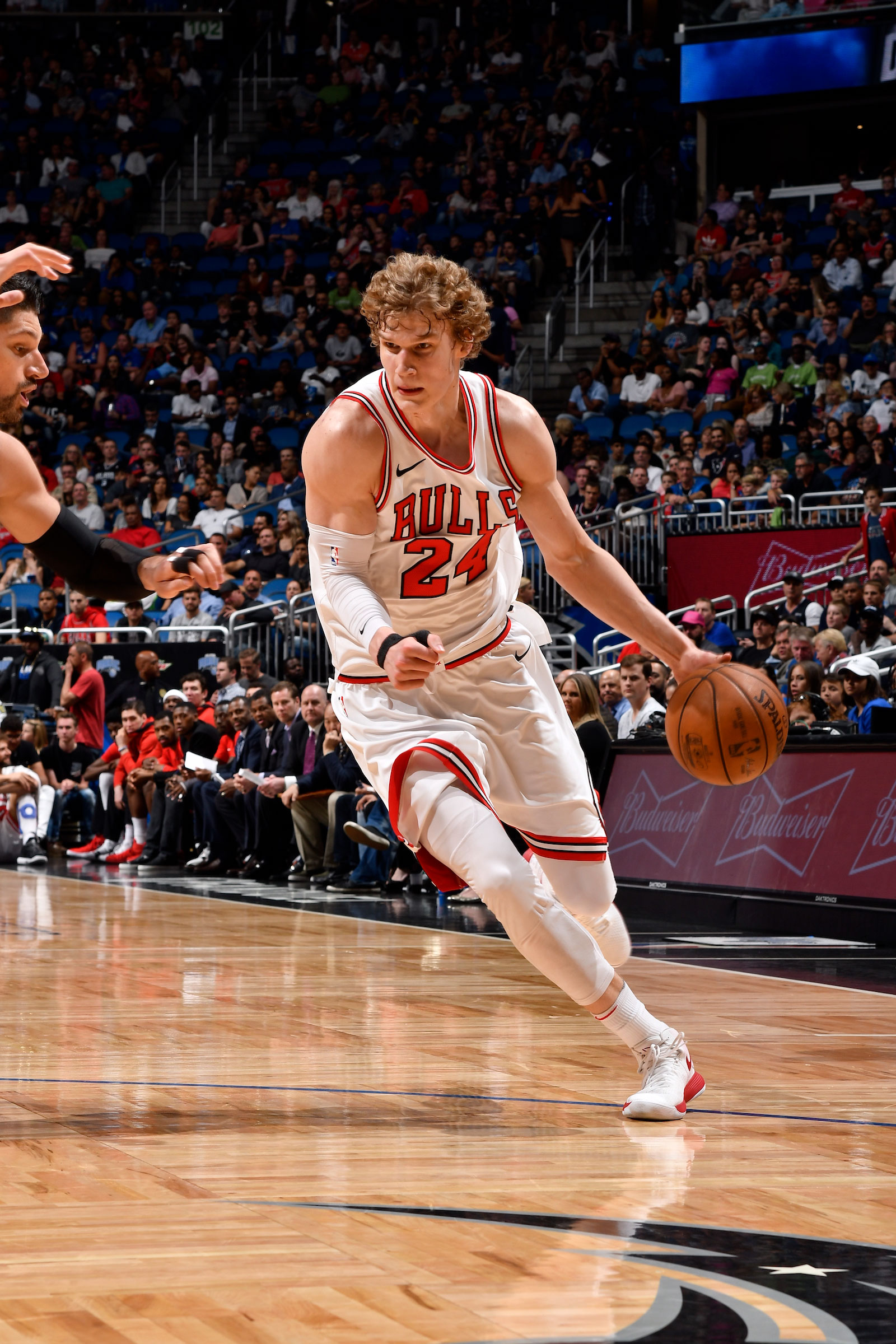 Lauri Markkanen #24 of the Chicago Bulls handles the ball against the Orlando Magic on March 30, 2018 at Amway Center in Orlando, Florida.