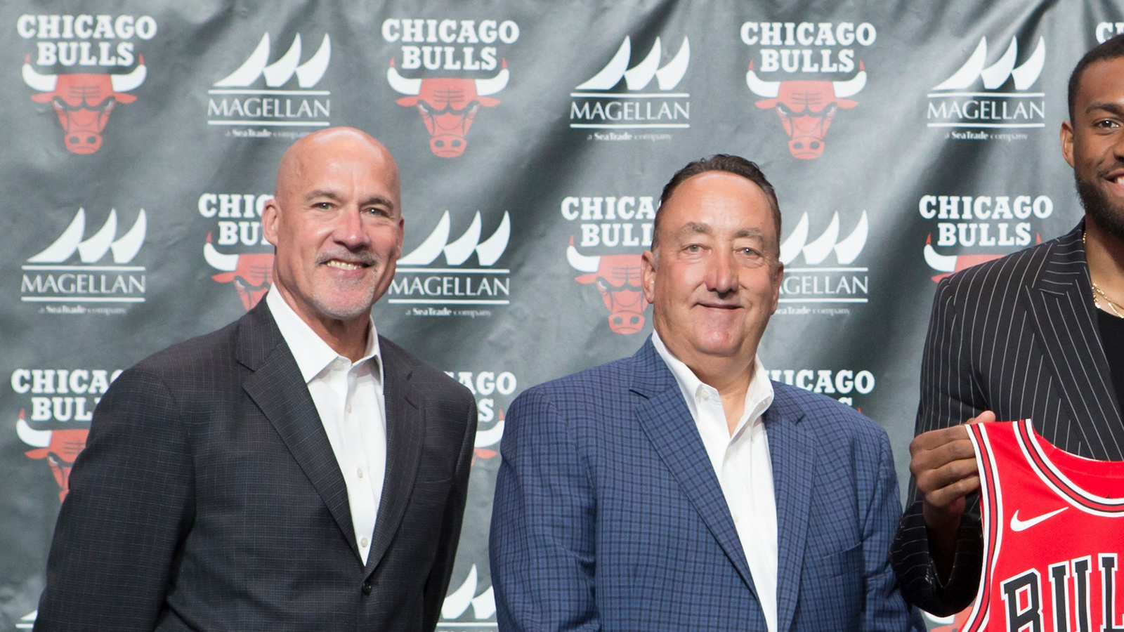 Gar Forman and John Pasxon pose for a photo at a press conference introducing Jabari Parker