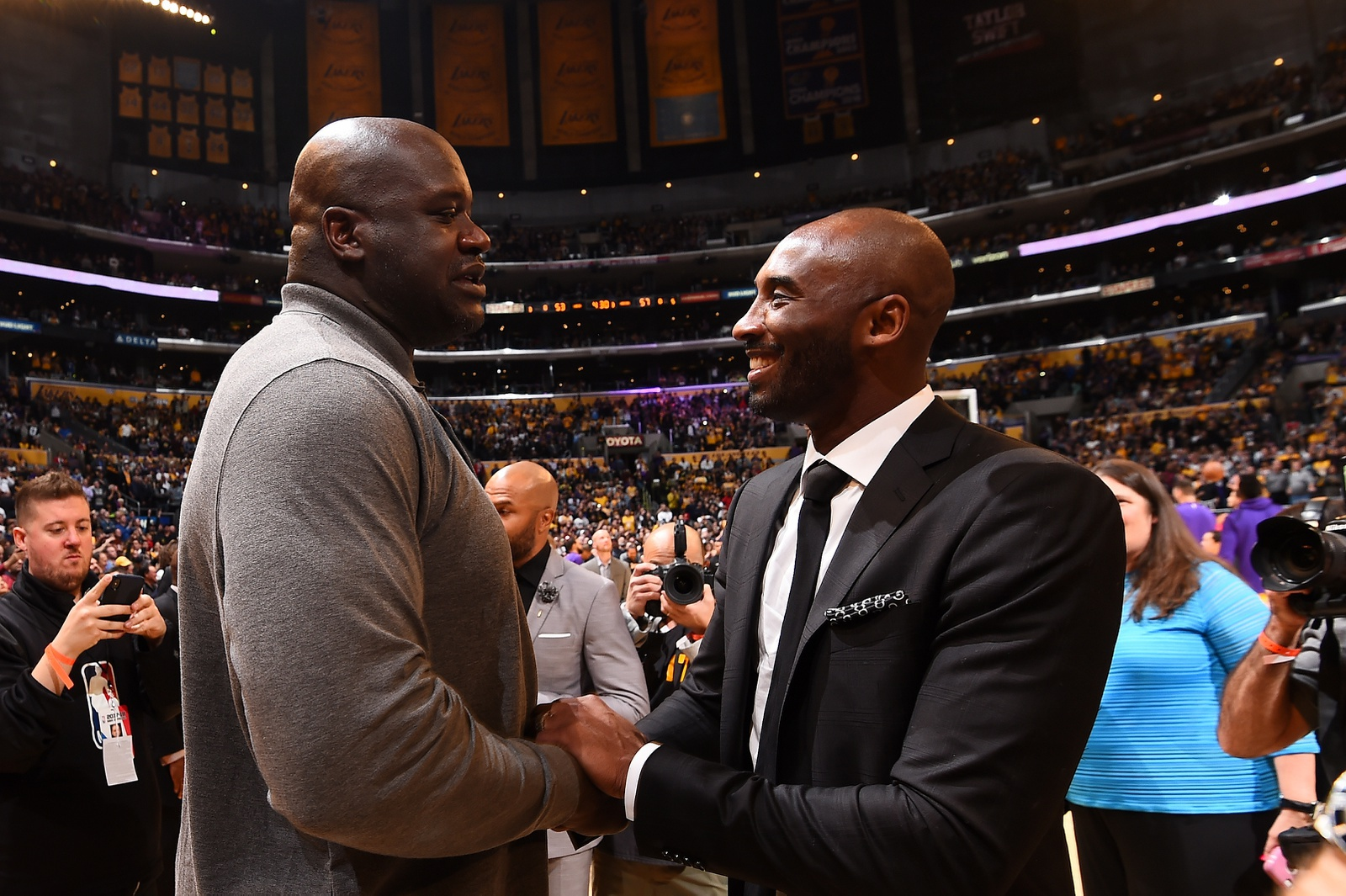 Shaquille O'Neal and Kobe Bryant greet after the jersey retirement ceremony on December 18, 2017 at STAPLES Center in Los Angeles, California.