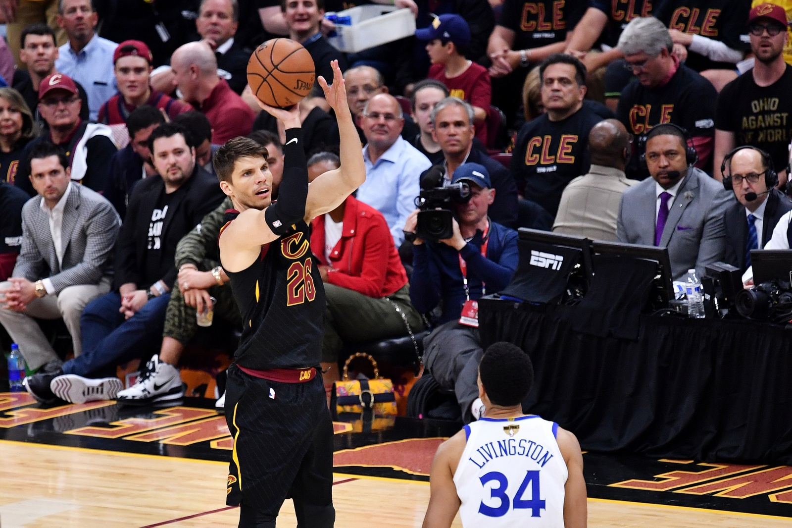 Kyle Korver #26 of the Cleveland Cavaliers shoots against Shaun Livingston #34 of the Golden State Warriors during Game Three of the 2018 NBA Finals at Quicken Loans Arena on June 6, 2018 in Cleveland, Ohio.
