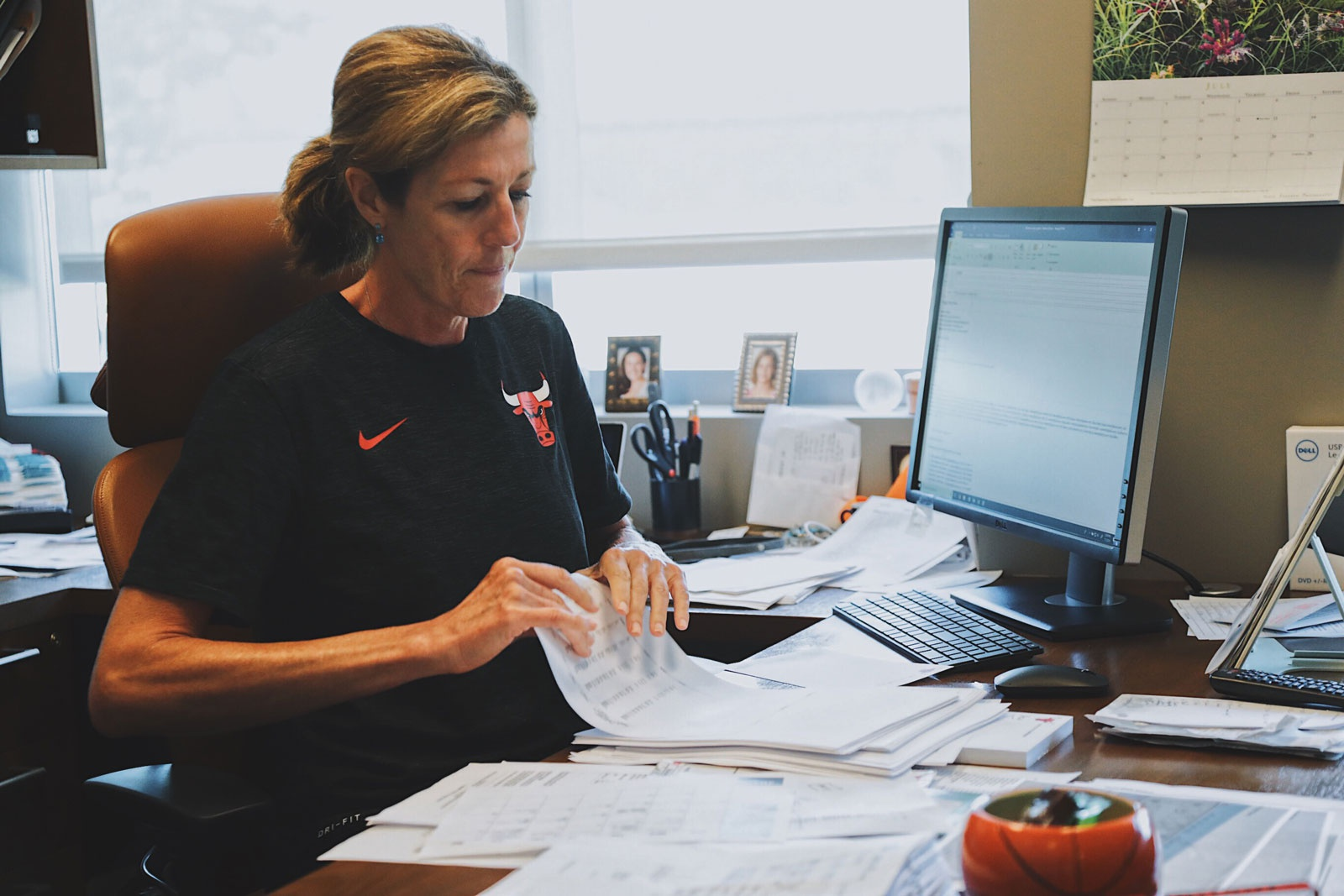 Karen Umlauf doing administrative work for the Bulls Operations.