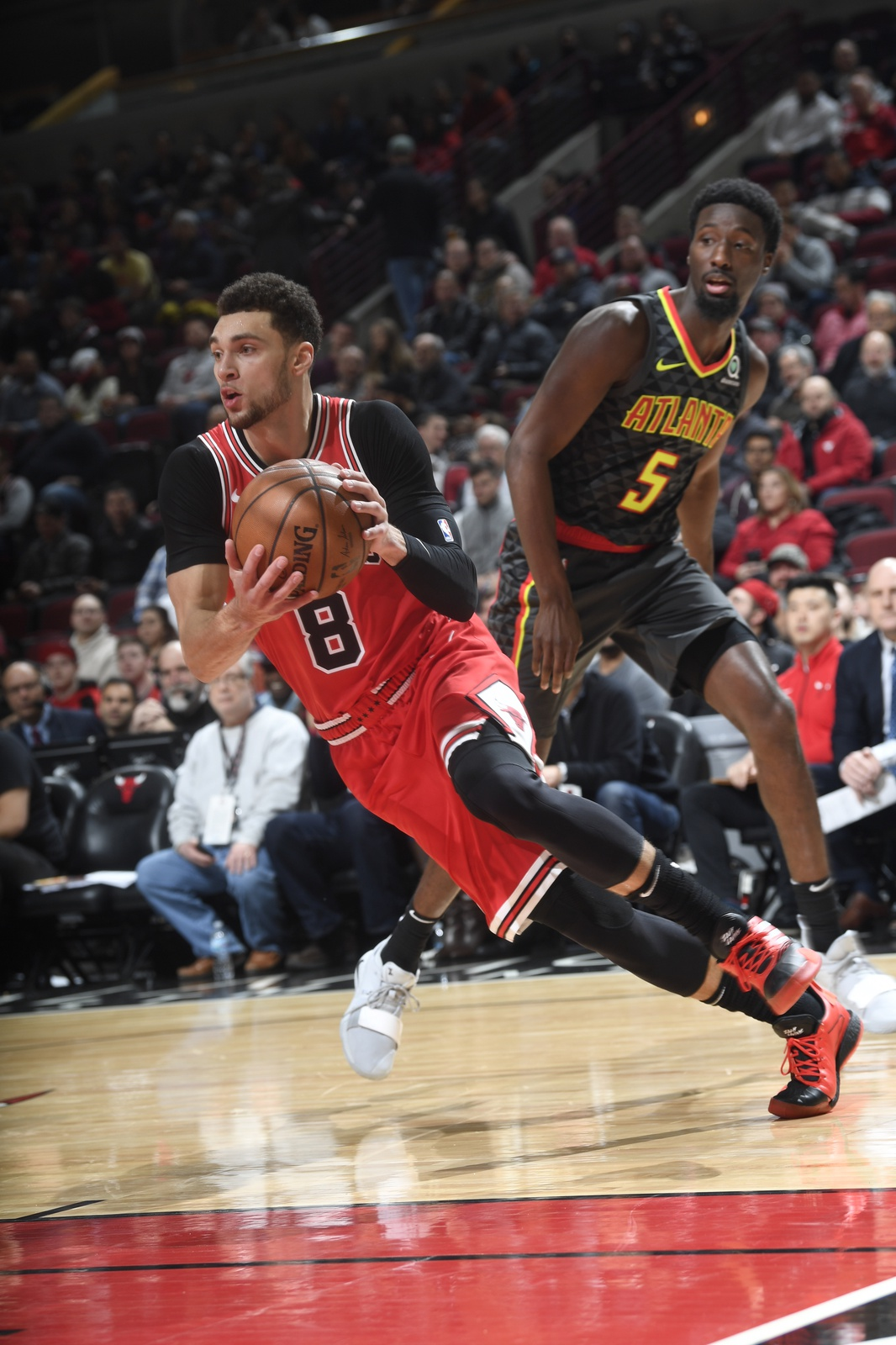 Zach LaVine dribbles the ball in a game against the Hawks
