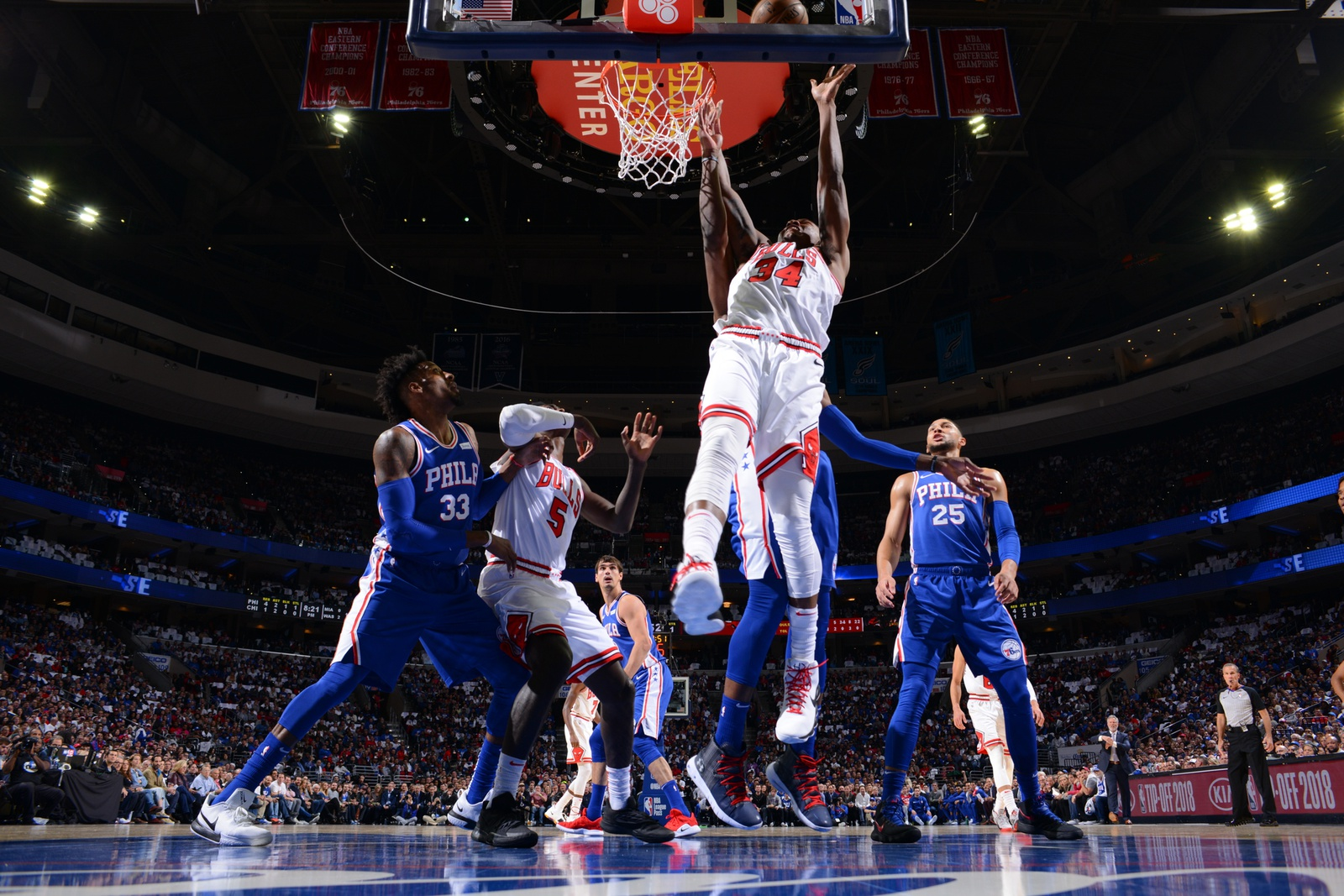 Wendell Carter Jr. of the Chicago Bulls attempts a rebound in the Bulls' season opener against the Philadelphia 76ers, October 18, 2018