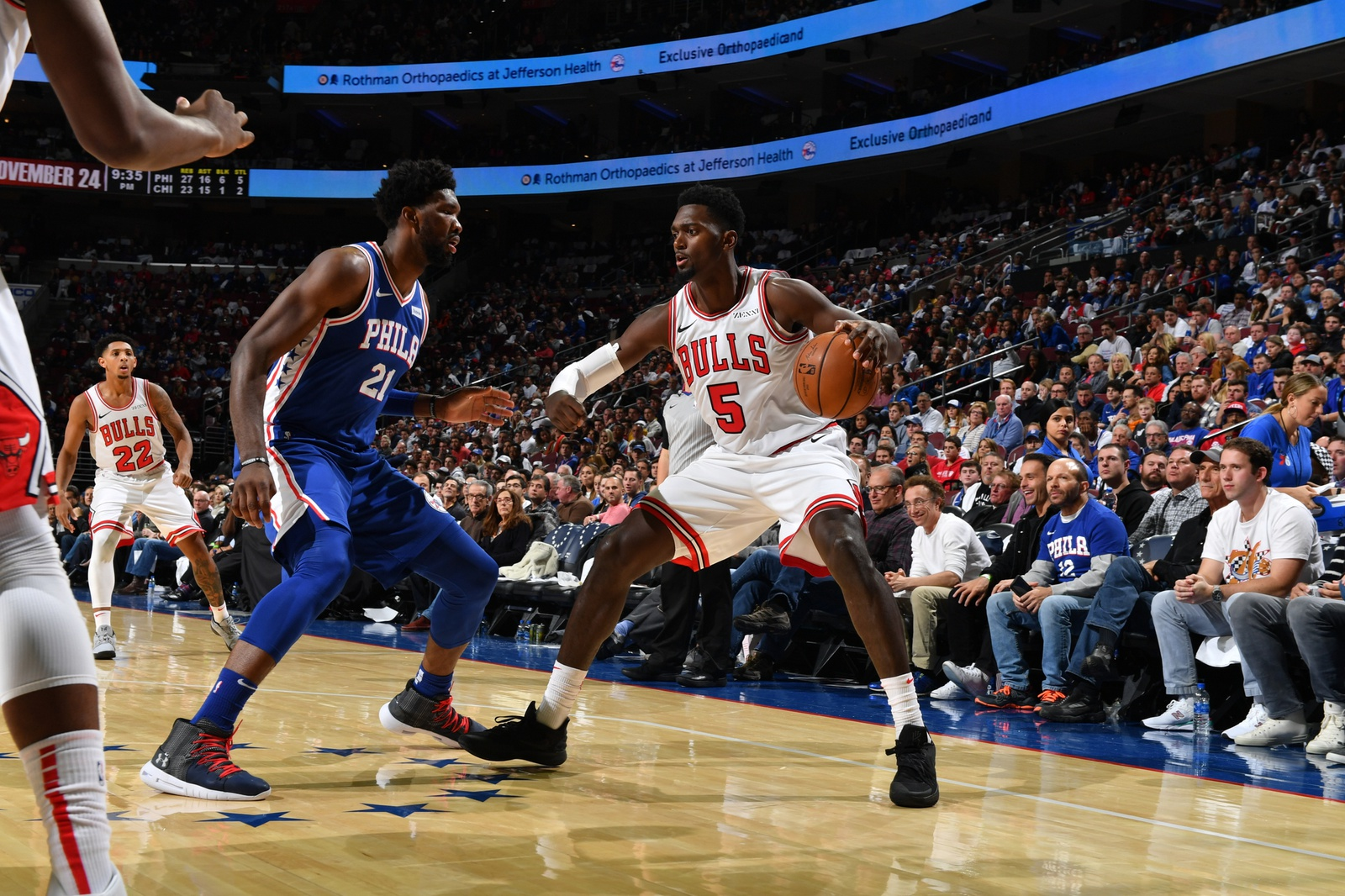 Bobby Portis of the Chicago Bulls dribbles the ball against Joel Embiid in the Bulls' season opener against the Philadelphia 76ers, October 18, 2018