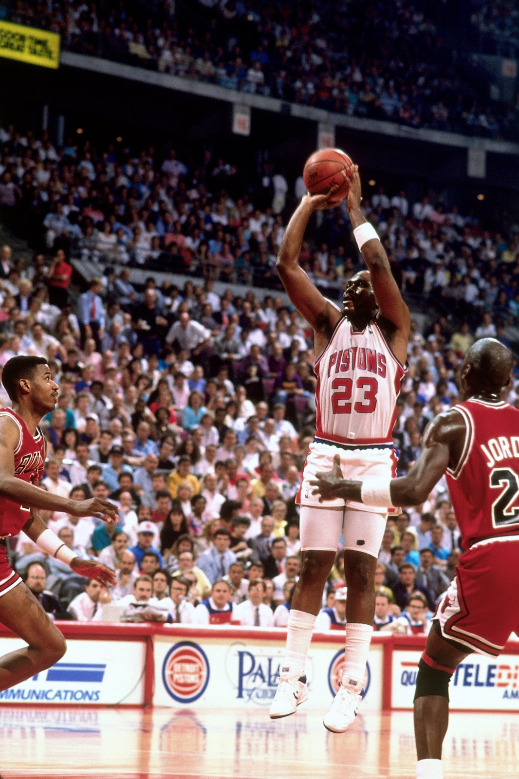 Mark Aguirre #23 of the Detroit Pistons shoots a jump shot over Scottie Pippen #33 of the Chicago Bulls during a 1989 playoff game played at the Palace of Auburn Hills in Auburn Hills, Michigan.