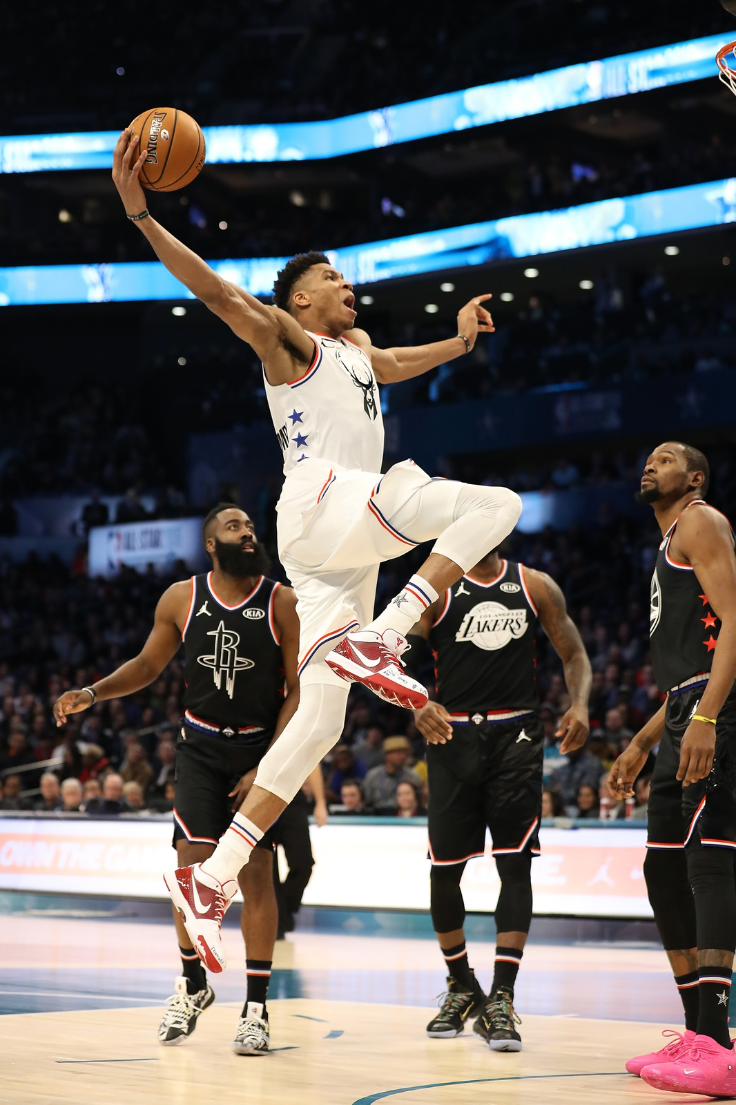 Giannis Antetokounmpo #34 of the Milwaukee Bucks and Team Giannis goes up to dunk against James Harden #13 of the Houston Rockets and Kevin Durant #35 of the Golden State Warriors and Team LeBron in the fourth quarter during the NBA All-Star game as part of the 2019 NBA All-Star Weekend at Spectrum Center on February 17, 2019 in Charlotte, North Carolina. Team LeBron won 178-164.