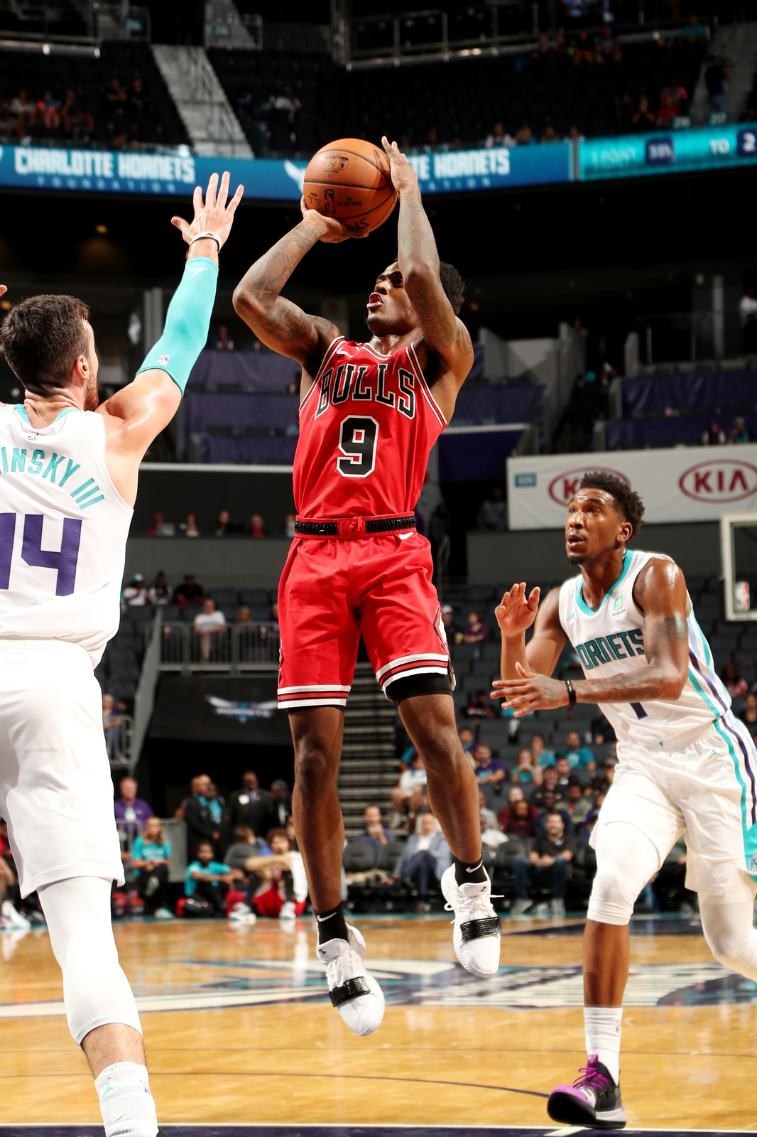 Antonio Blakeney #9 of the Chicago Bulls shoots the ball against the Charlotte Hornets during a pre-season game on October 8, 2018 at Spectrum Center in Charlotte, North Carolina.