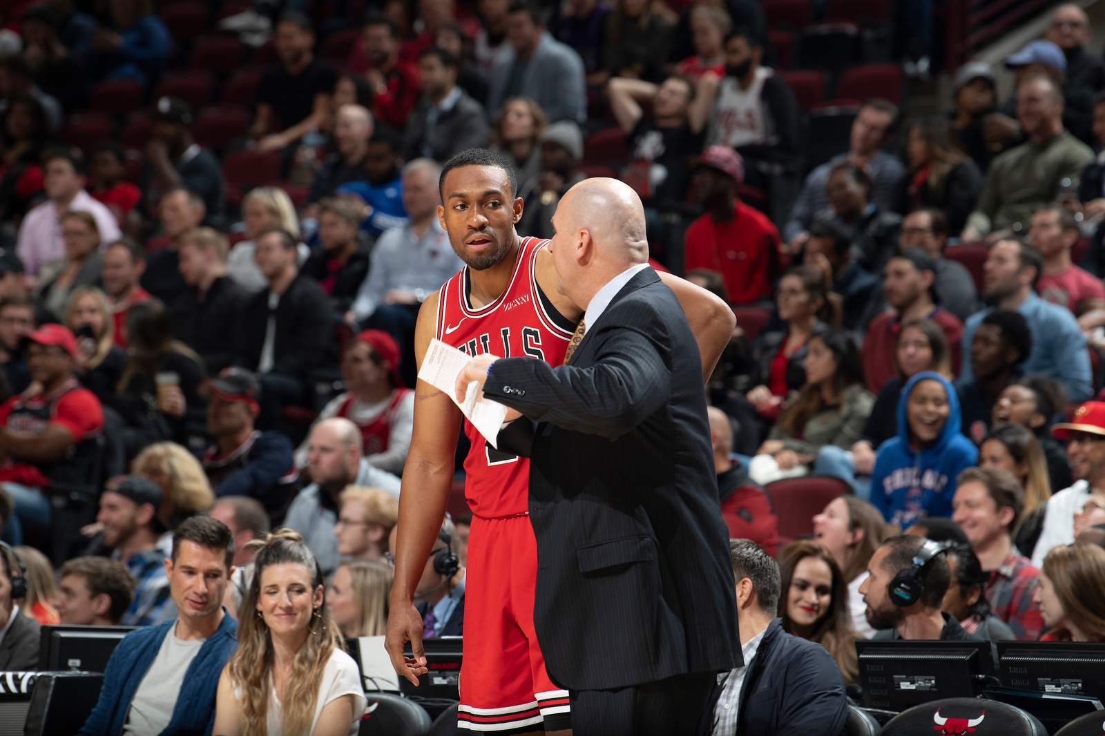 Jim Boylen talks with Jabari Parker during a game.
