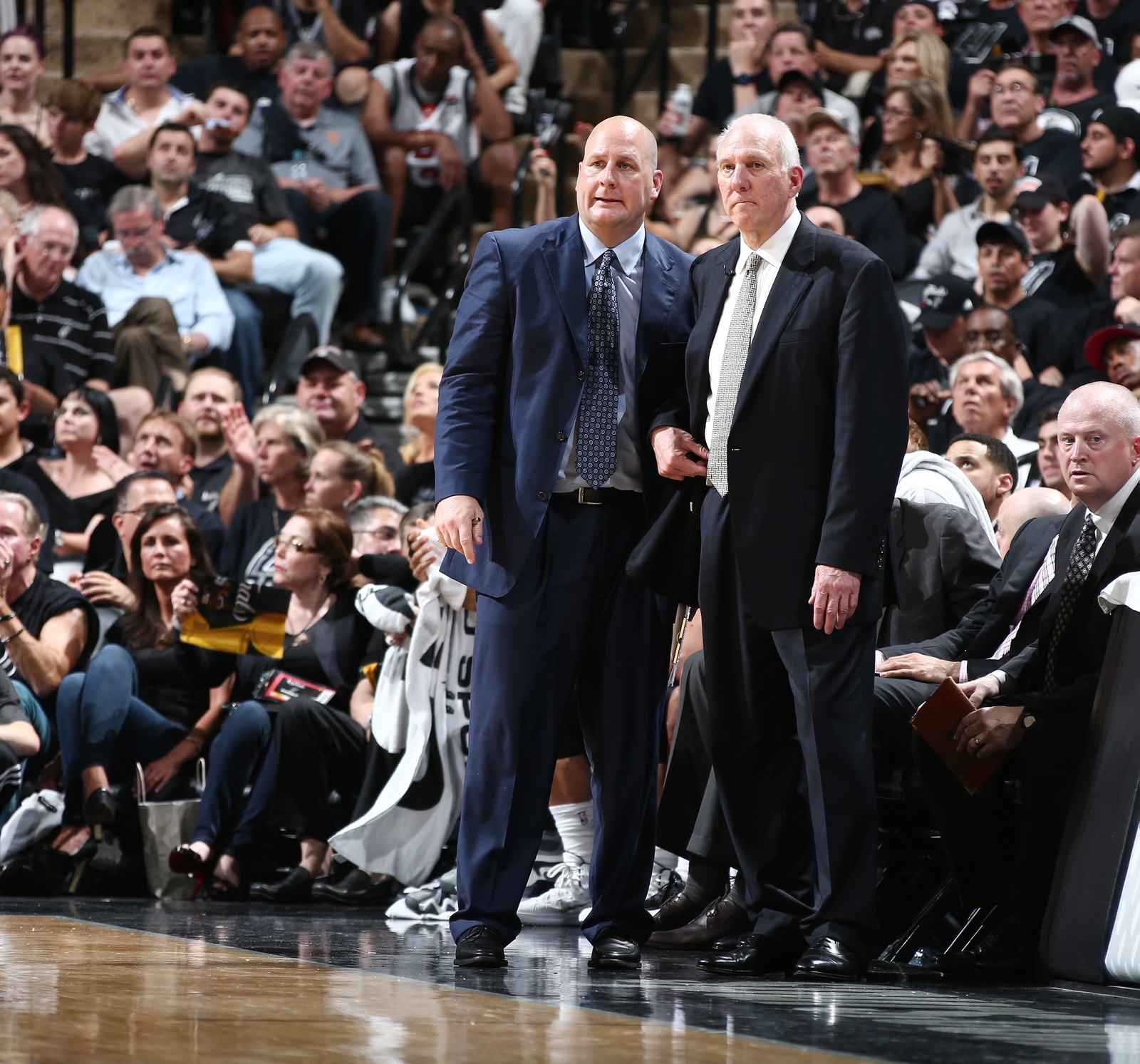Head Coach Gregg Popovich and Assistant Coach Jim Boylen of the San Antonio Spurs in Game One of the 2014 NBA Finals at AT&T Center on June 5, 2014 in San Antonio, Texas.