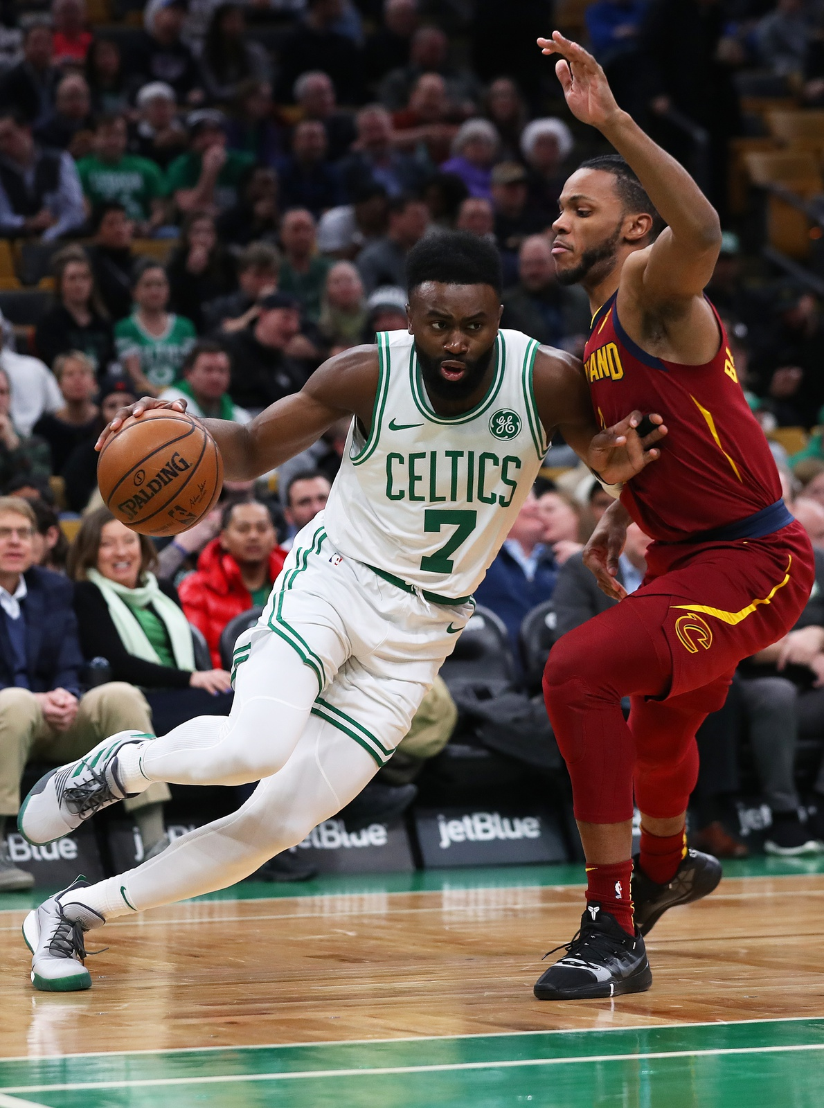 Jaylen Brown #7 of the Boston Celtics drives against Jaron Blossomgame #4 of the Cleveland Cavaliers during the first half at TD Garden on January 23, 2019 in Boston, Massachusetts.