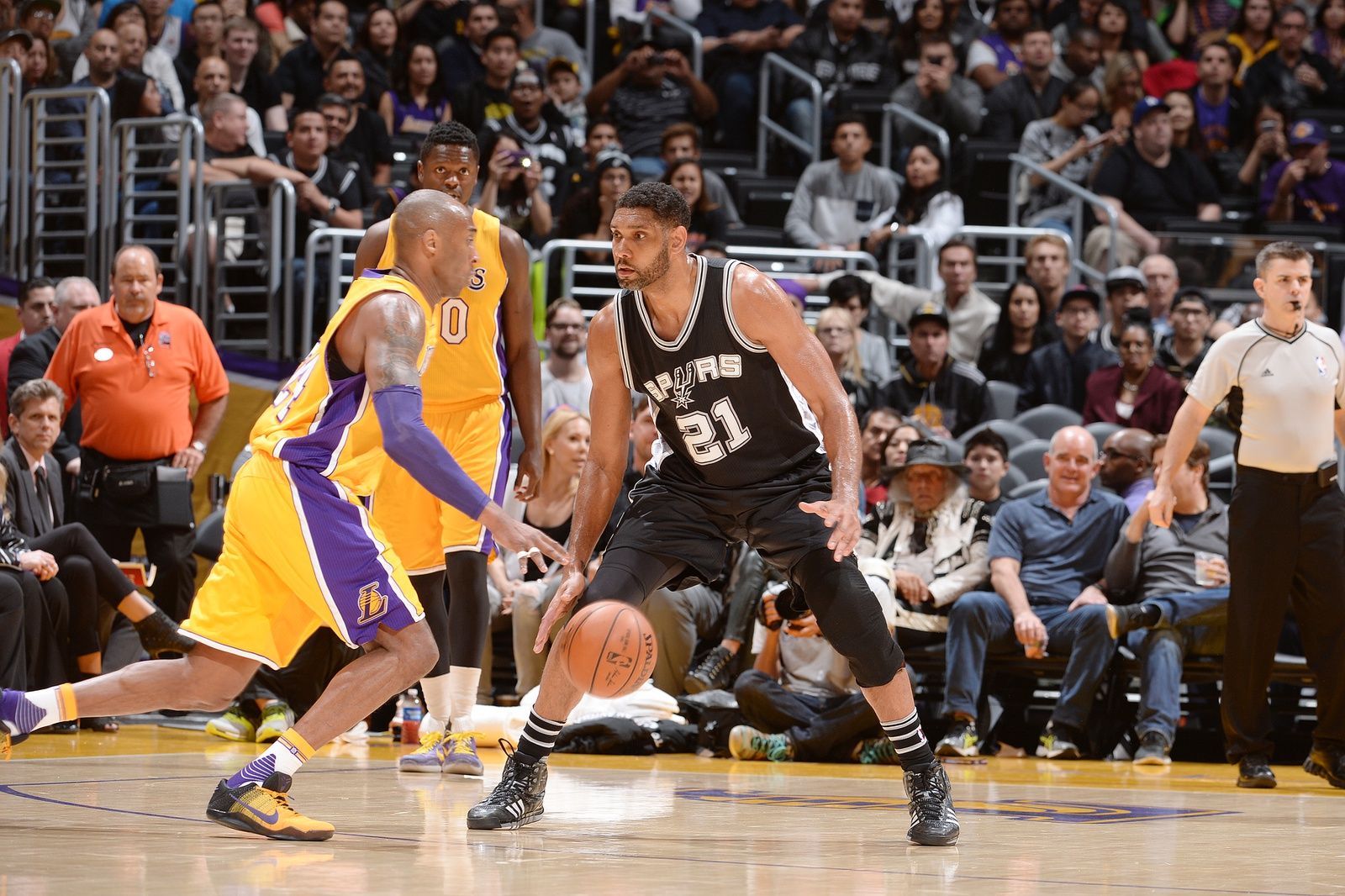 Kobe Bryant #24 of the Los Angeles Lakers handles the ball against Tim Duncan #21 of the San Antonio Spurs on February 19, 2016 at STAPLES Center in Los Angeles, California.
