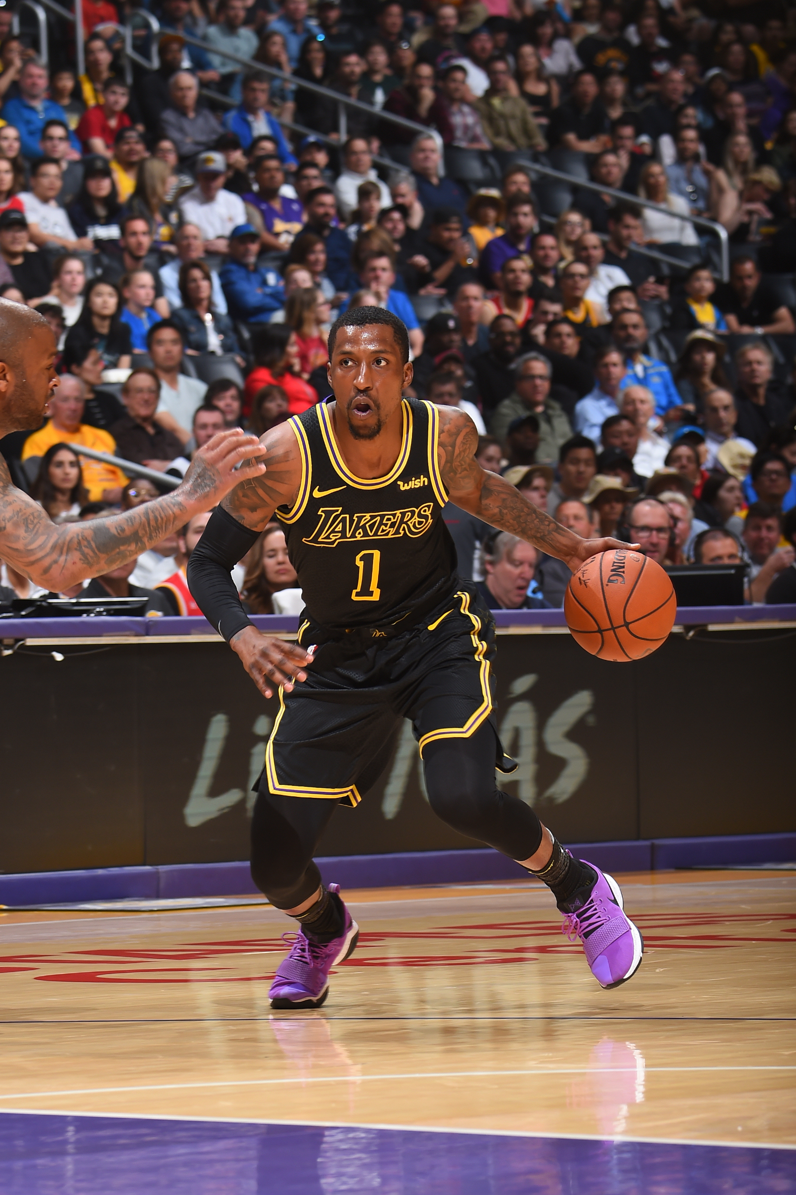 Kentavious Caldwell-Pope #1 of the Los Angeles Lakers handles the ball against the Houston Rockets on April 10, 2017 at STAPLES Center in Los Angeles, California.