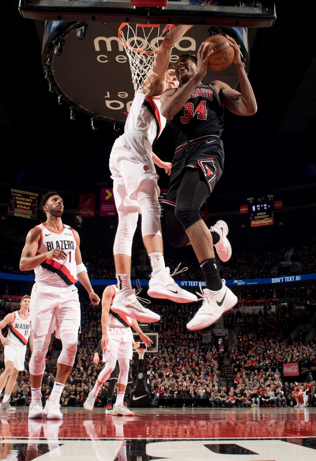 Wendell Carter Jr. #34 of the Chicago Bulls shoots the ball during the game against Jusuf Nurkic #27 of the Portland Trail Blazers on January 9, 2019 at the Moda Center Arena in Portland, Oregon.