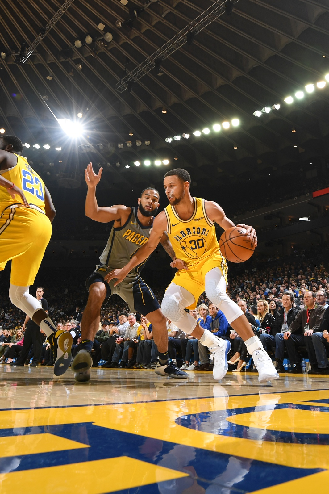 Stephen Curry #30 of the Golden State Warriors handles the ball against the Indiana Pacers on March 21, 2019 at ORACLE Arena in Oakland, California.