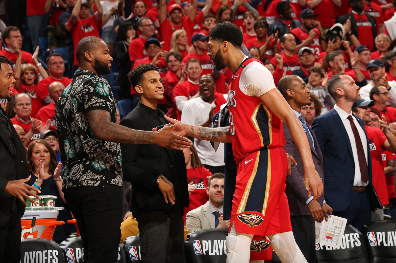 Anthony Davis #23 of the New Orleans Pelicans high-fives DeMarcus Cousins #0 of the New Orleans Pelicans during the game against the Portland Trail Blazers in Game Three of Round One of the 2018 NBA Playoffs on April 19, 2018 at Smoothie King Center in New Orleans, Louisiana.