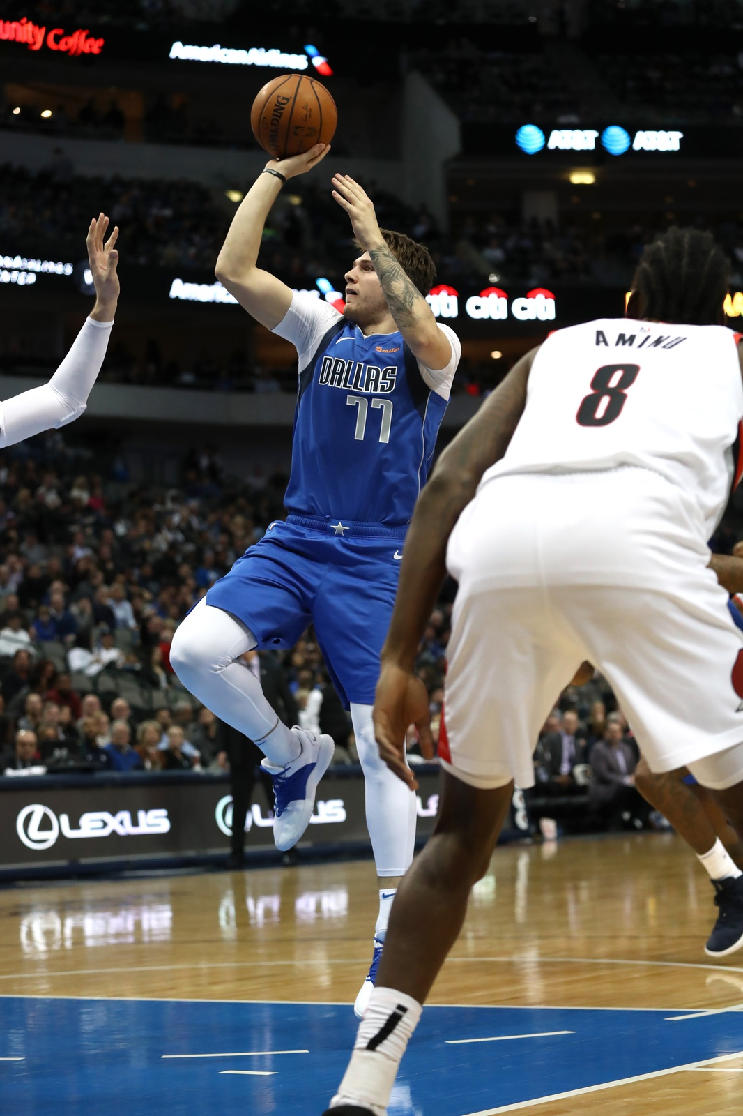Luka Doncic #77 of the Dallas Mavericks takes a shot against the Portland Trail Blazers in the second half at American Airlines Center on December 04, 2018 in Dallas, Texas.