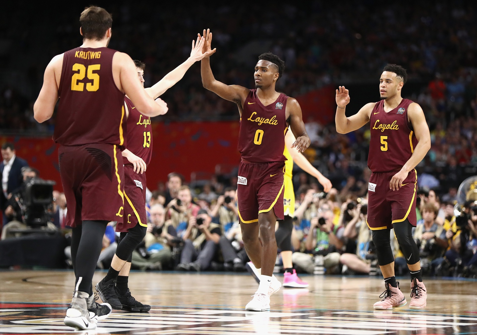 Donte Ingram #0 of the Loyola Ramblers celebrates with teammates late in the first half against the Michigan Wolverines during the 2018 NCAA Men's Final Four Semifinal at the Alamodome on March 31, 2018 in San Antonio, Texas.