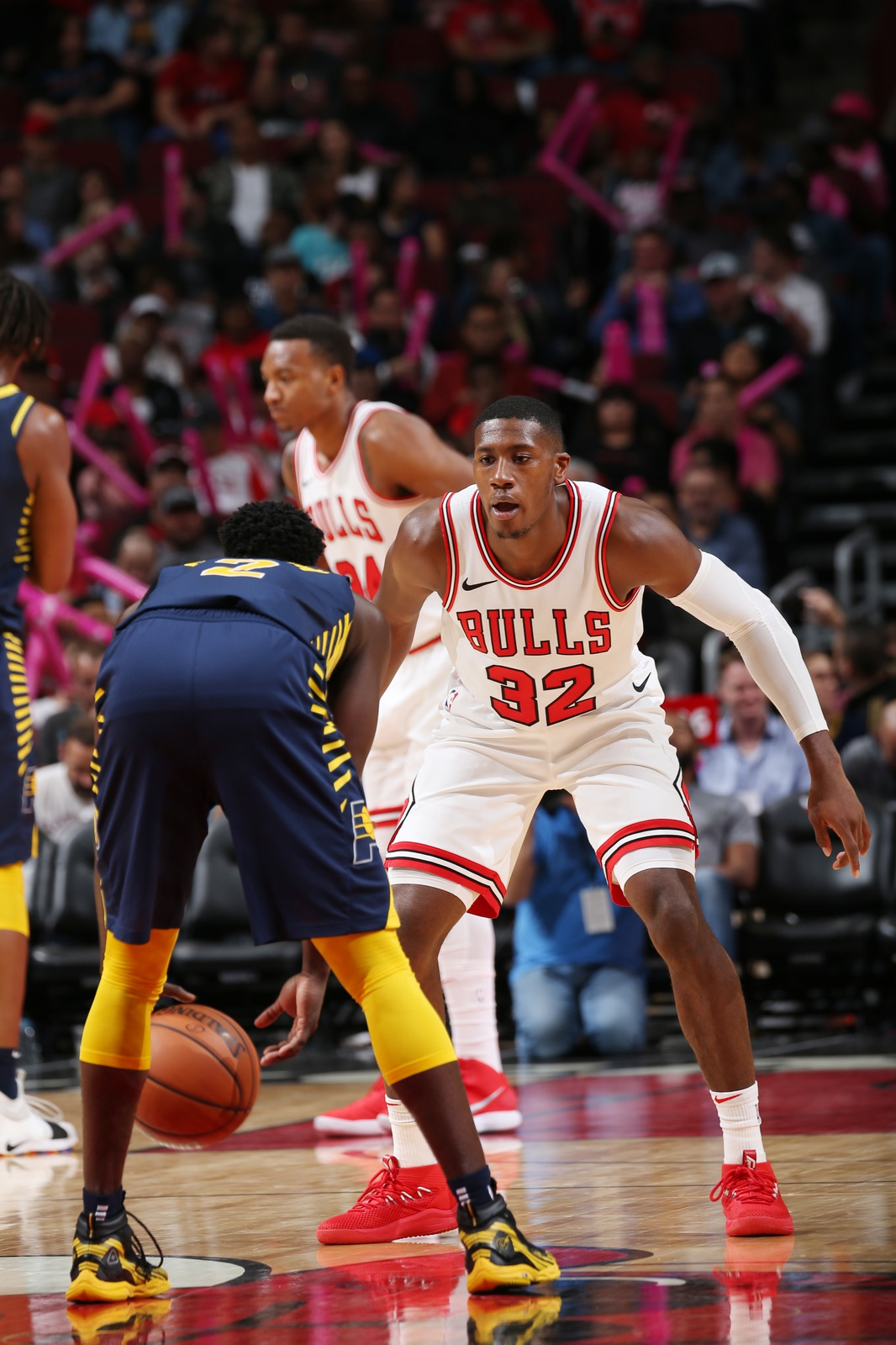 Victor Oladipo #4 of the Indiana Pacers drives against Kris Dunn #32 of the Chicago Bulls during a preseason game at the United Center on October 10, 2018 in Chicago, Illinois.