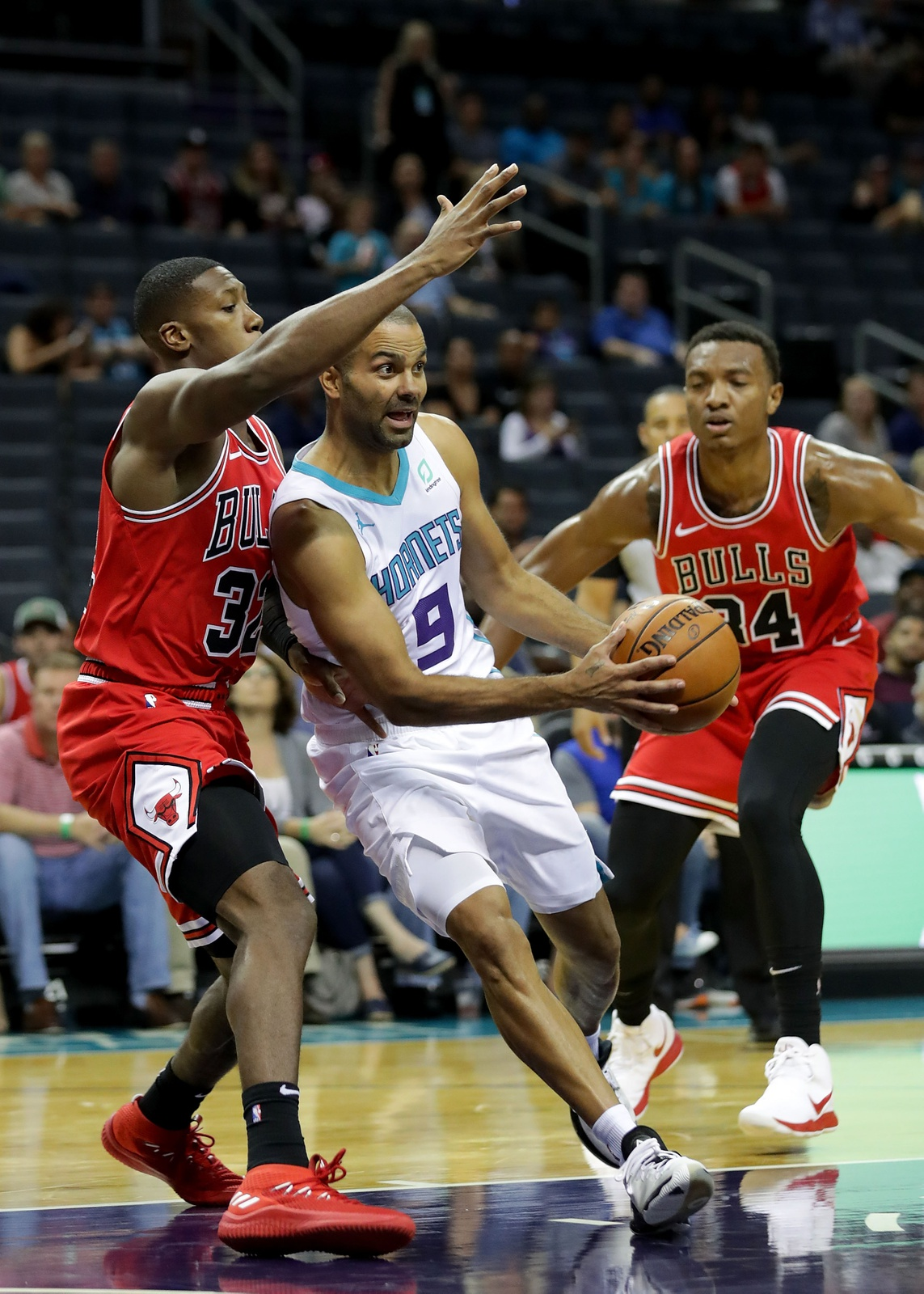 Tony Parker #9 of the Charlotte Hornets drives to the basket against Kris Dunn #32 of the Chicago Bulls during their game at Spectrum Center on October 8, 2018 in Charlotte, North Carolina.