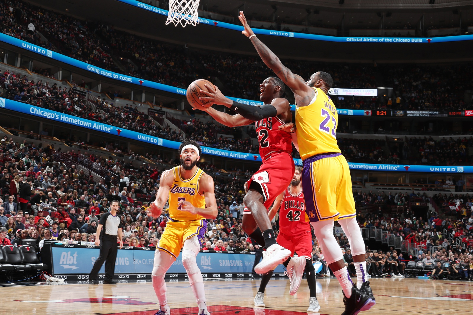 Kris Dunn #32 of the Chicago Bulls shoots the ball against the Los Angeles Lakers on March 12, 2019 at the United Center in Chicago, Illinois.