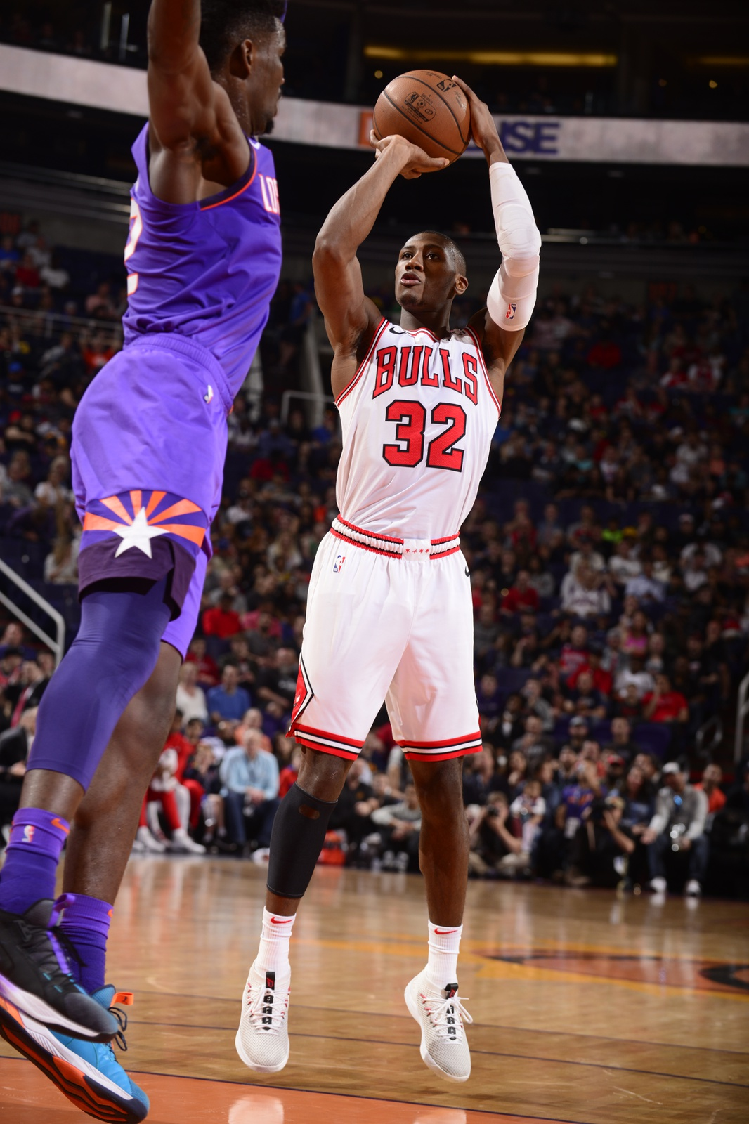 Kris Dunn #32 of the Chicago Bulls shoots the ball against the Phoenix Suns on March 18, 2019 at Talking Stick Resort Arena in Phoenix, Arizona.
