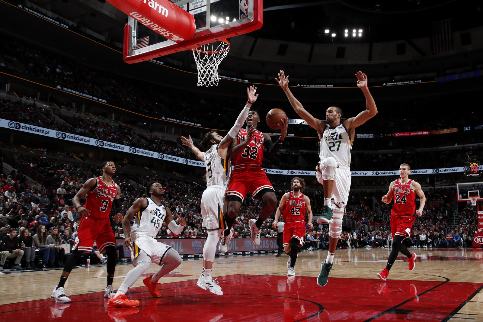 Kris Dunn #32 of the Chicago Bulls shoots the ball against the Utah Jazz on March 23, 2019 at United Center in Chicago, Illinois.