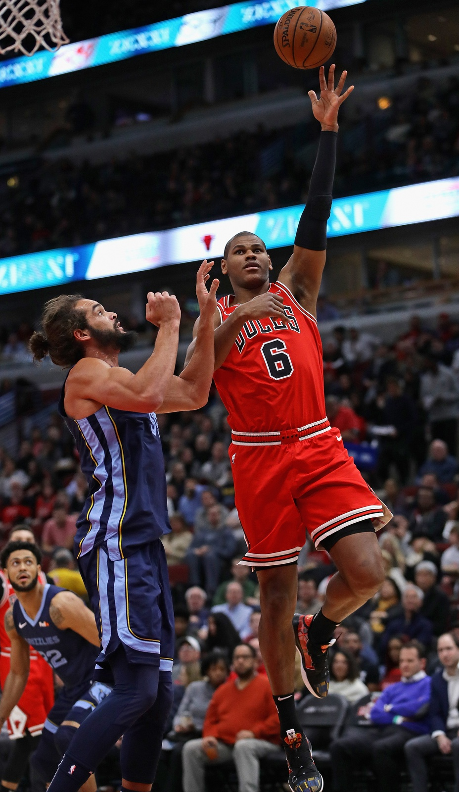 Cristiano Felicio #6 of the Chicago Bulls shoots over Joakim Noah #55 of the Memphis Grizzlies at the United Center on February 13, 2019 in Chicago, Illinois.