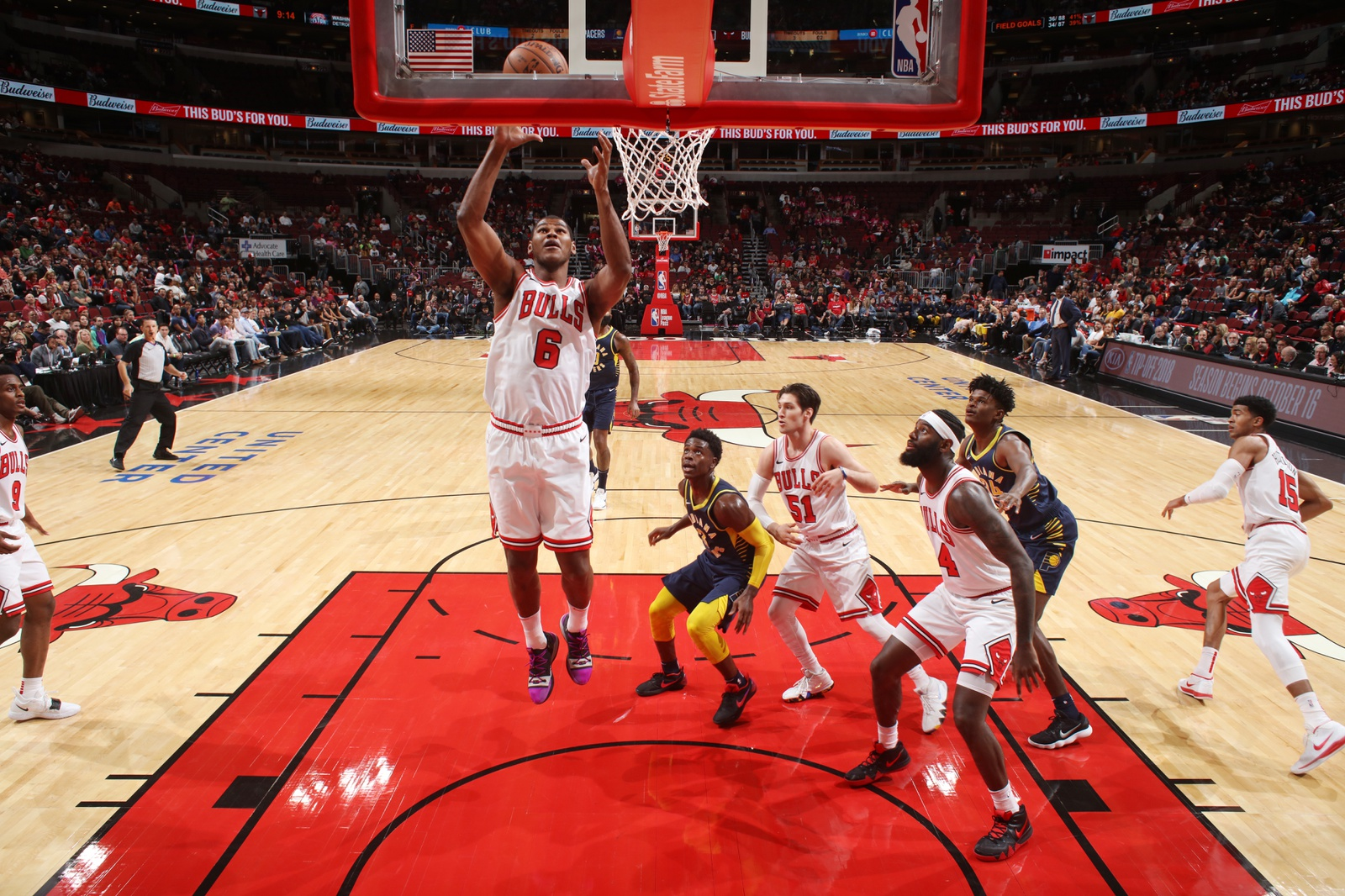 Cristiano Felicio \#6 of the Chicago Bulls shoots the ball against the Indiana Pacers during a pre-season game on October 10, 2018 at the United Center in Chicago, Illinois.