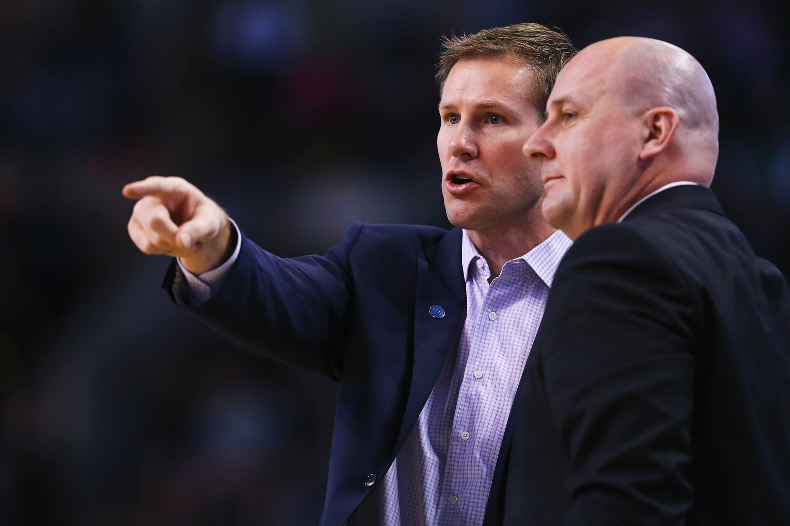 Fred Hoiberg head coach of the Chicago Bulls talks with assistant coach Jim Boylen during the second half at TD Garden on December 9, 2015 in Boston, Massachusetts. The Celtics defeat the Bulls 105-100.