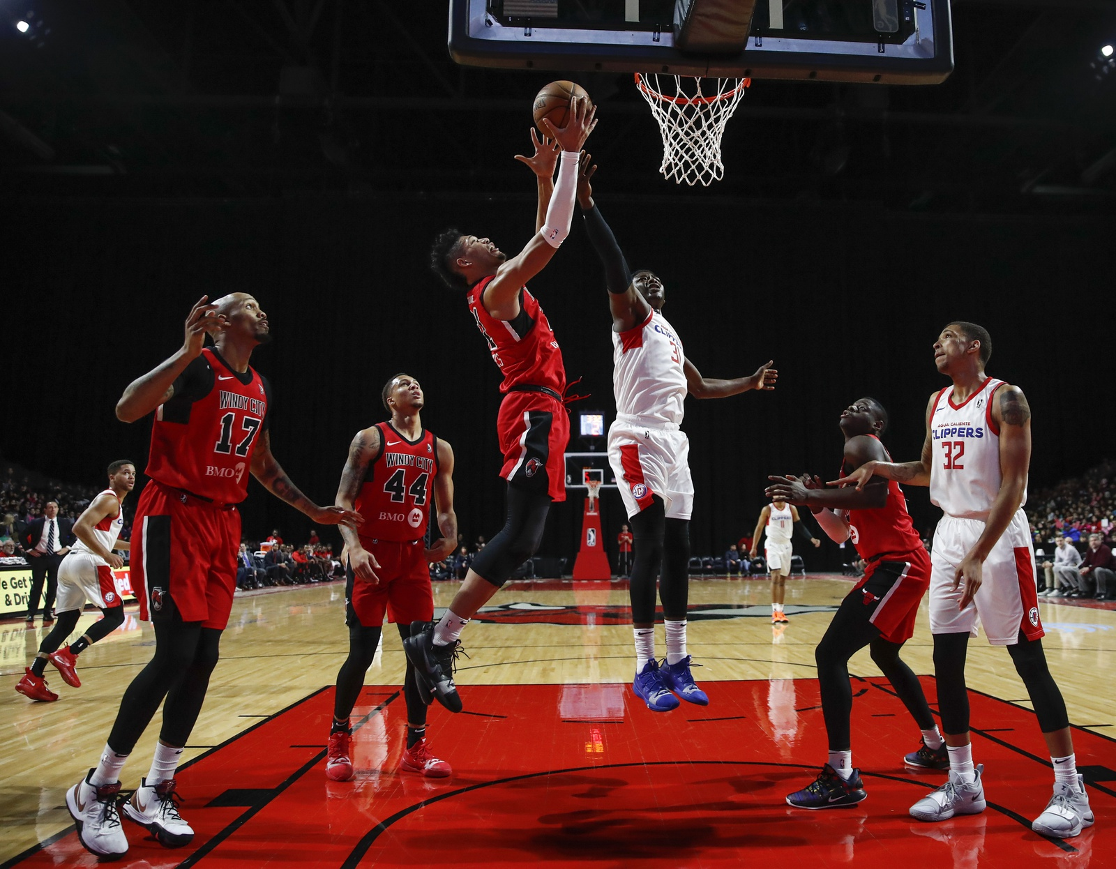 Kaiser Gates #21 of the Windy City Bulls battles for the ball with Angel Delgado #31 of the Agua Caliente Clippers during the first half of an NBA G-League game on February 20, 2019 at Sears Centre Arena in Hoffman Estates, Illinois.