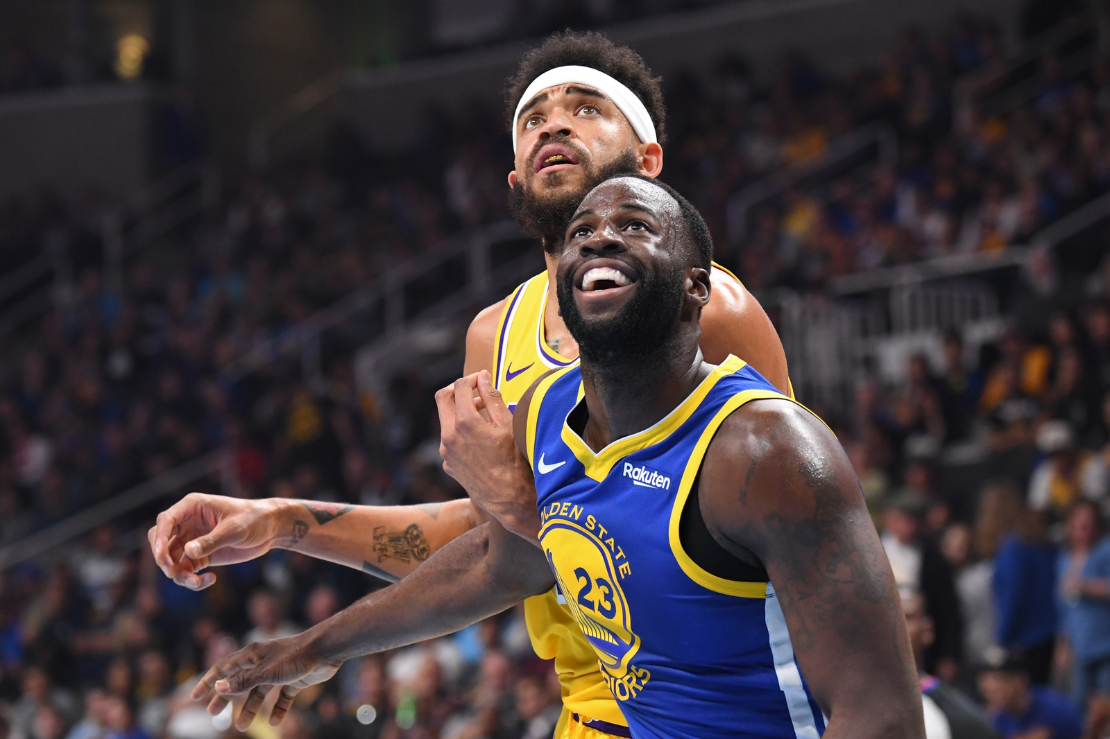 Draymond Green #23 of the Golden State Warriors boxes out JaVale McGee #7 of the Los Angeles Lakers during a pre-season game on October 12, 2018 at the SAP Center in San Jose, California.