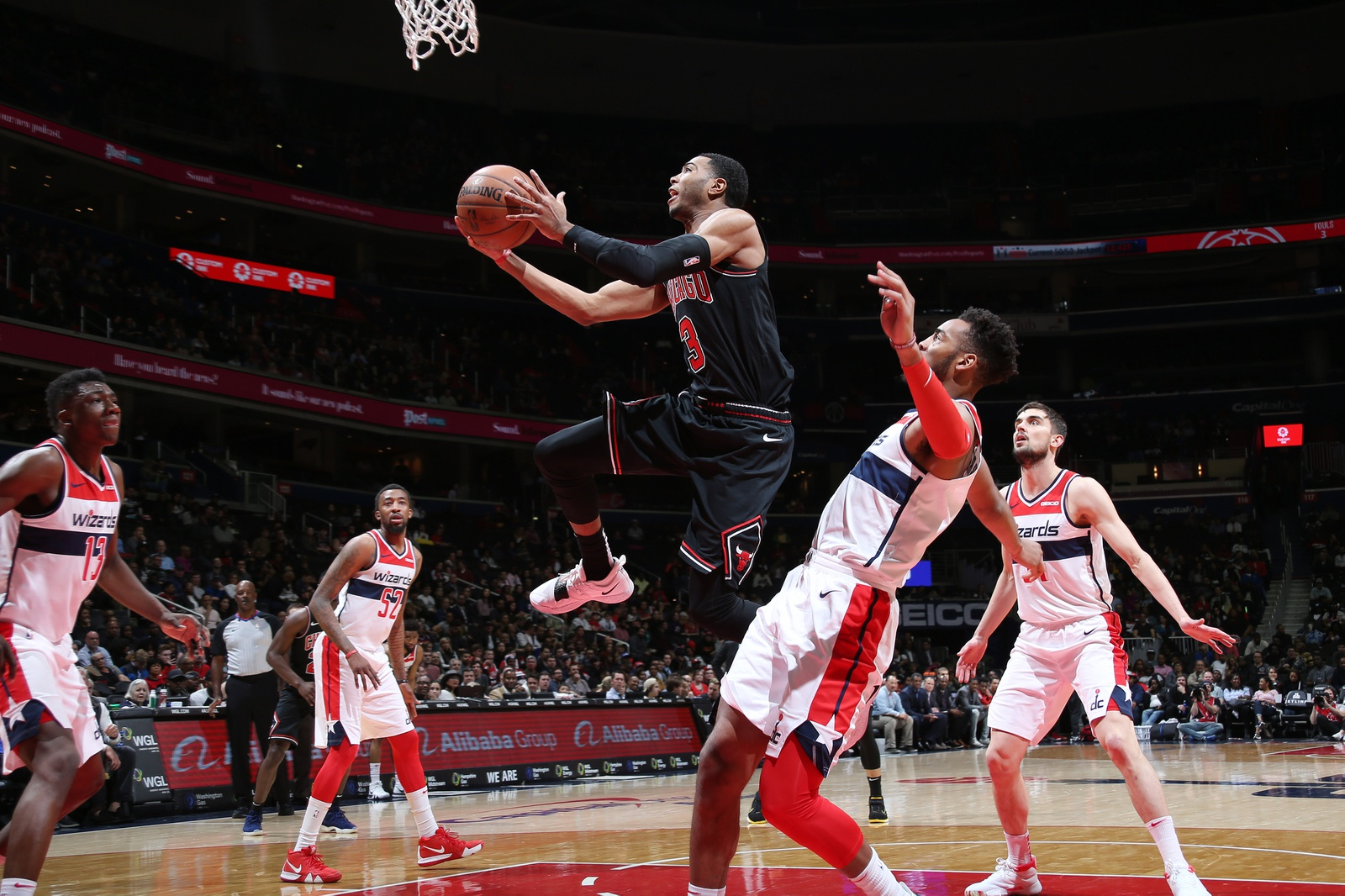 Shaquille Harrison #3 of the Chicago Bulls shoots the ball against the Washington Wizards on April 3, 2019 at Capital One Arena in Washington, DC.