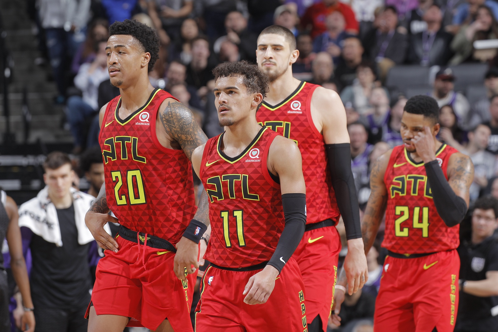 John Collins #20, Trae Young #11, Alex Len #25 and Kent Bazemore #24 of the Atlanta Hawks face the Sacramento Kings on January 30, 2019 at Golden 1 Center in Sacramento, California.